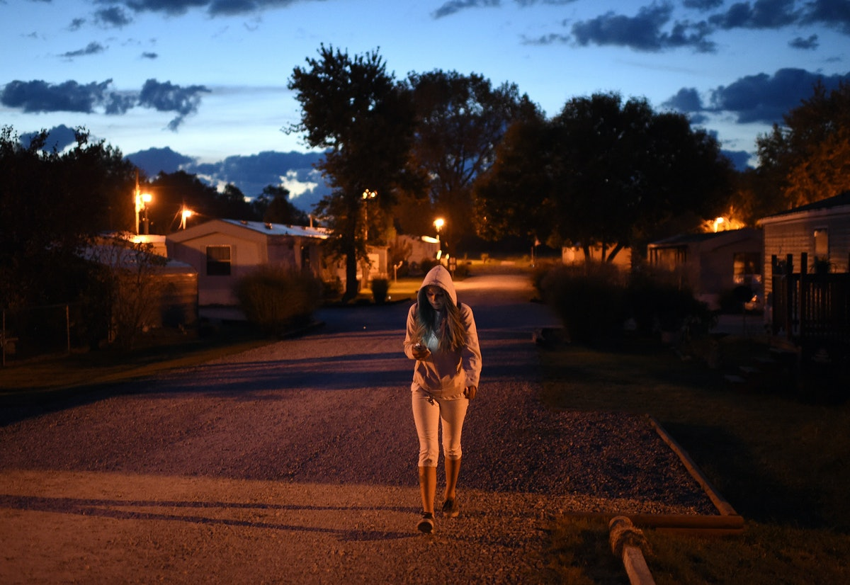 Krista Downey Walks Her Route To Work Friday In The Perryville Mobile Home Park