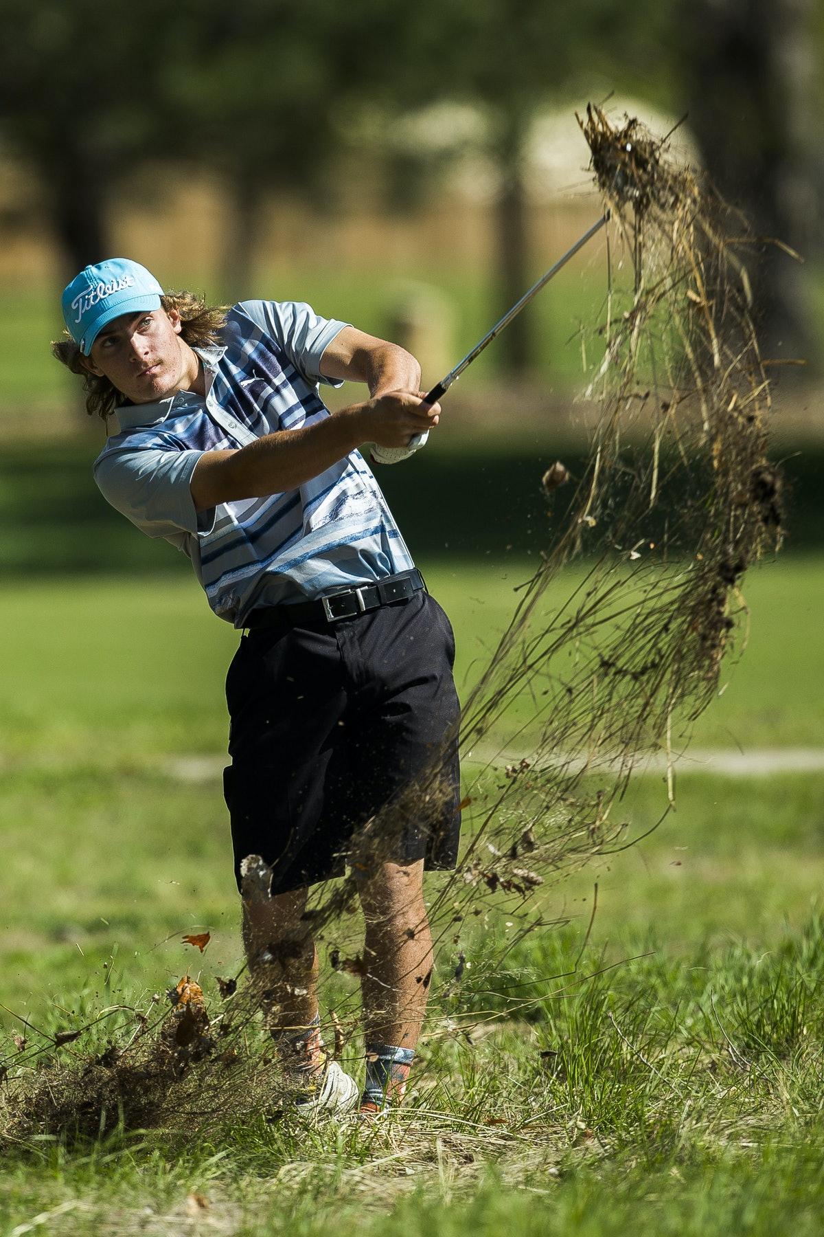 PEisenhower High Schools Tyler Trudo Chips Out Of The Rough During Hutchinson